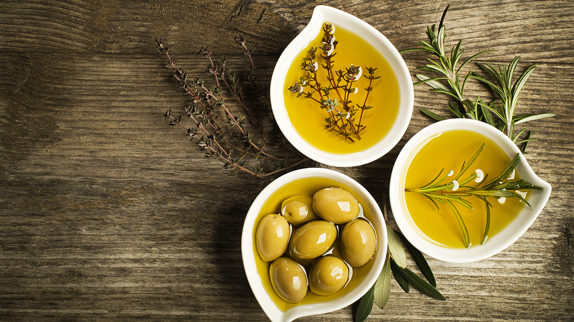 Greek herbs and olives in olive oil